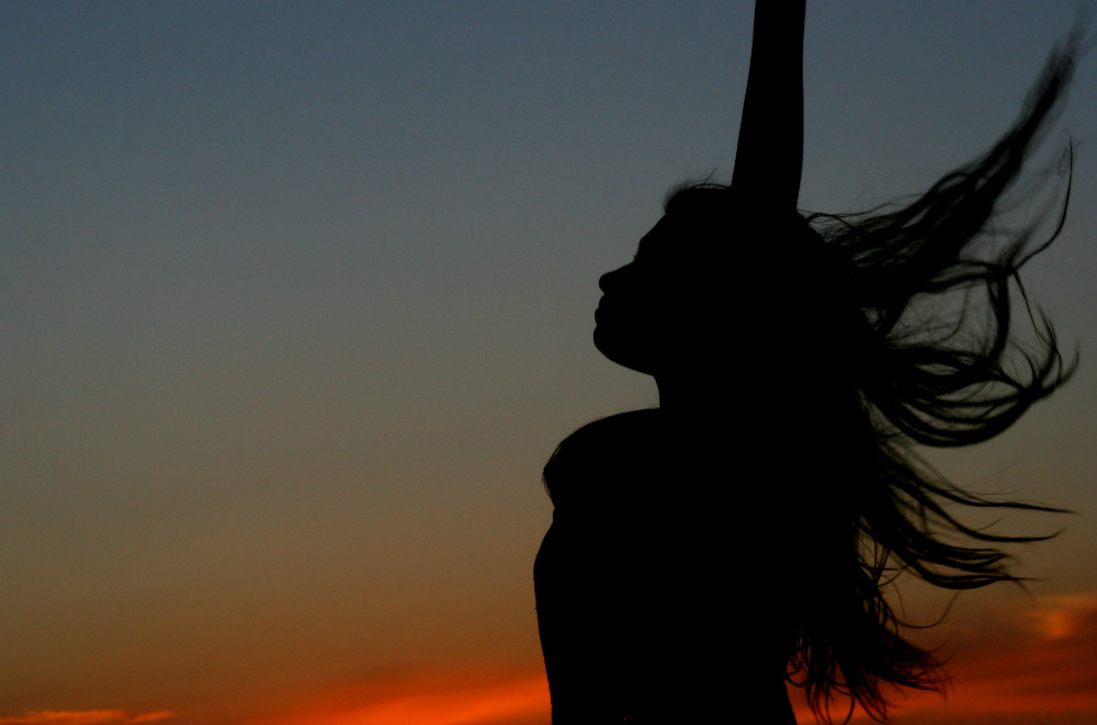 sunset-girl-shadow-1000x661